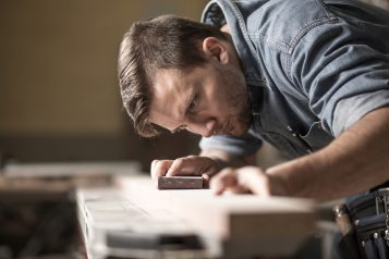Cabinetmaker during work in workshop